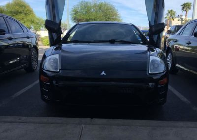 Front angle view of a black Mitsubishi Eclipse